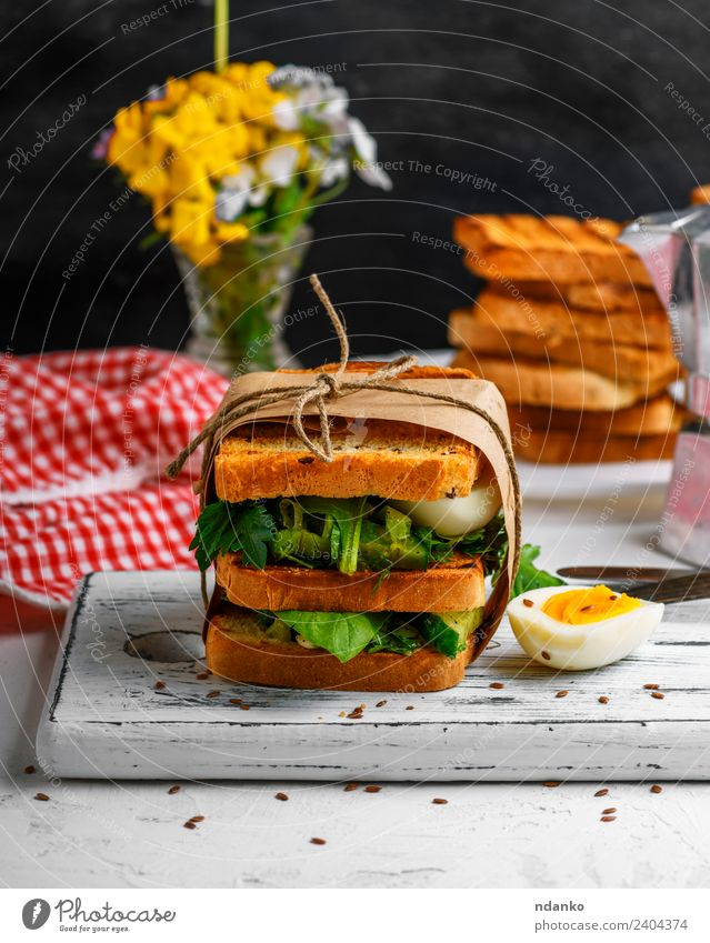 sandwich of French toast and lettuce leaves Meat Vegetable Lettuce Salad Bread Breakfast Lunch Dinner Vegetarian diet Table Flower Fresh Delicious Brown Green