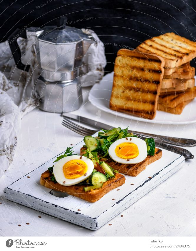 bread from white wheat flour with boiled egg Vegetable Bread Breakfast Lunch Dinner Vegetarian diet Coffee Plate Fork Eating Fresh Delicious Brown Green White