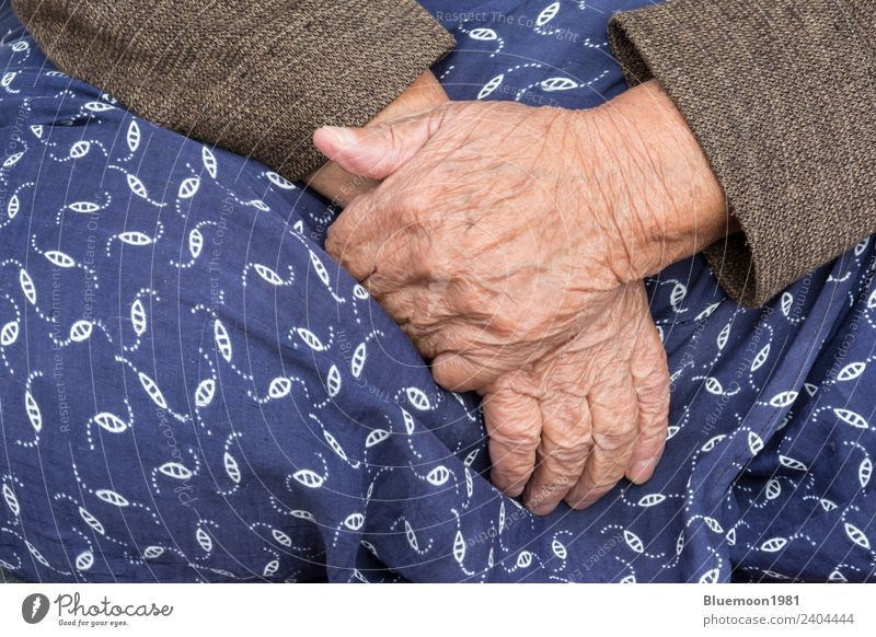 A Detail of An Old Woman Hands On Her Traditional Skirt Lifestyle Body Skin Retirement Human being Feminine Adults Grandmother Fingers Cloth Blue