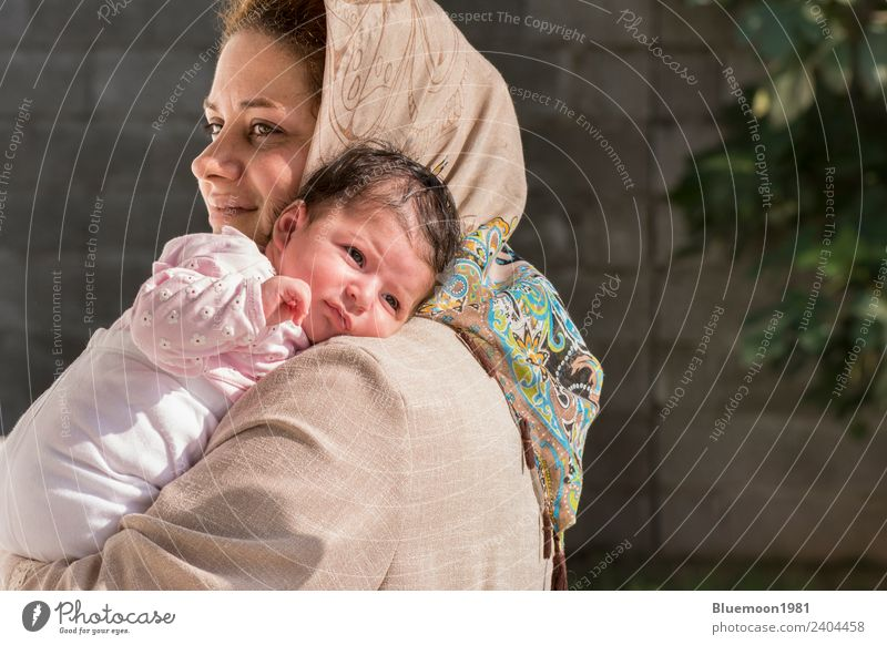Muslim mother caring a little newborn baby in outdoor Woman Child Human being Beautiful Relaxation Adults Lifestyle Healthy Love Emotions Feminine
