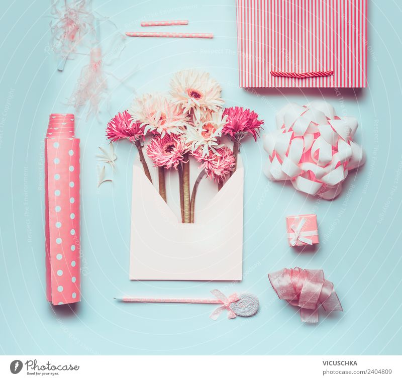 Flowers in envelope with pink gift wrapping Accessories Shopping Style Design Summer Desk Feasts & Celebrations Valentine's Day Mother's Day Easter Wedding