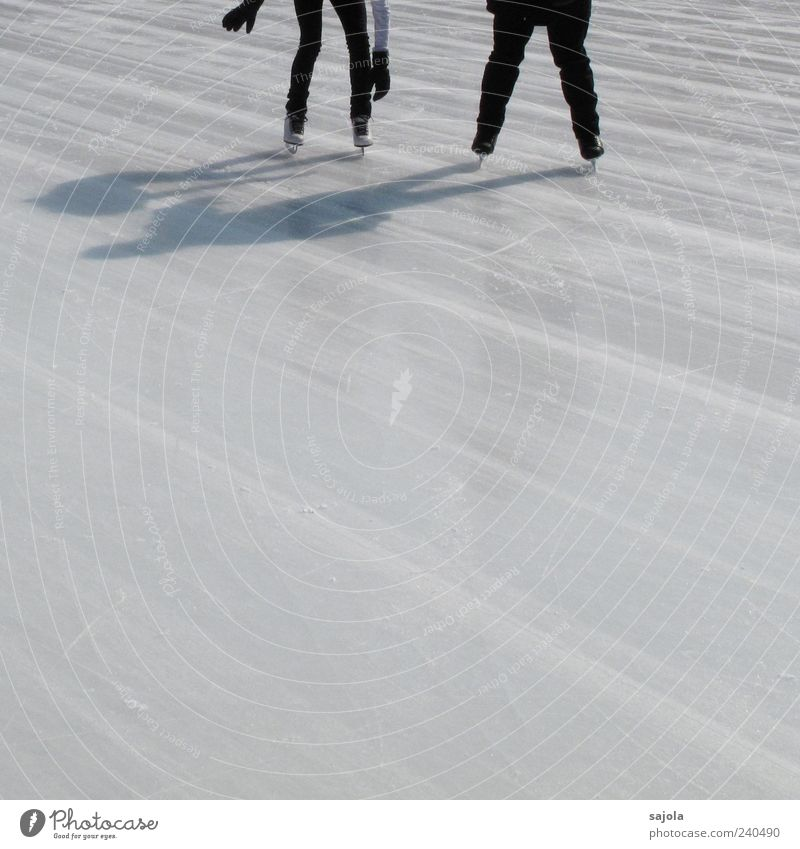 offer help Winter sports Ice-skating Human being 2 Driving Stand White Frozen surface Line Shadow play Colour photo Exterior shot Copy Space bottom Day
