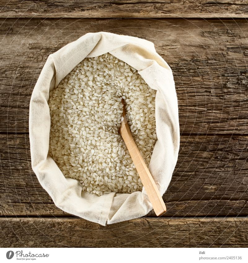 Raw Arborio Risotto Rice Grain Nutrition White food arborio risotto Italian Ingredients cooking European dry Dried Staple Cereal starchy bag overhead Top Rustic