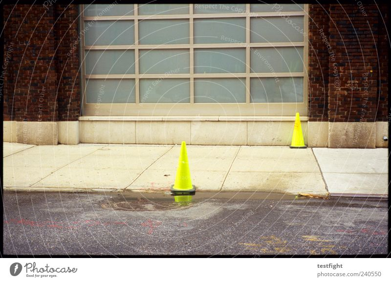 Yellow Street Wall (building) Wall (barrier) Facade Signs and labeling Signage Safety Warning label Traffic infrastructure Warning sign Neon Traffic cone