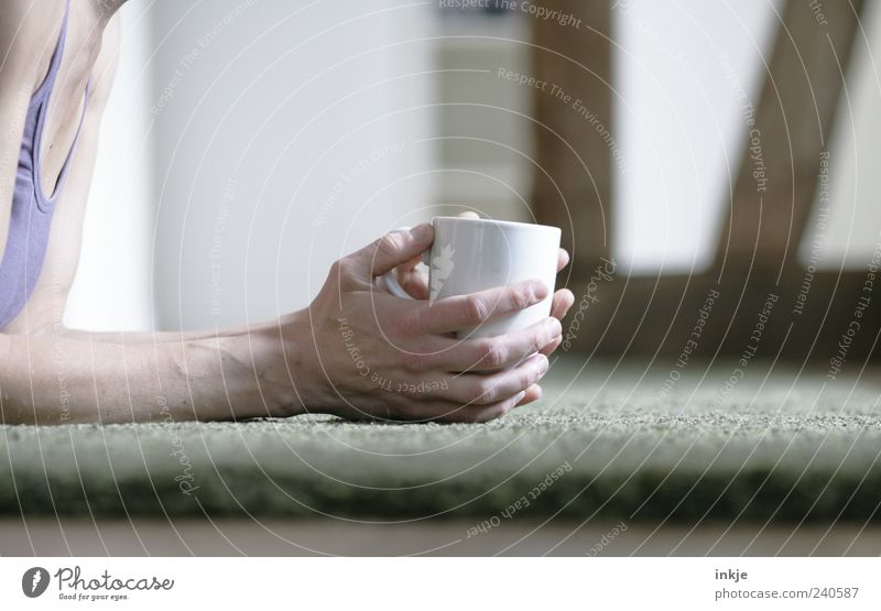 lie around drinking coffee Well-being Relaxation Calm Living or residing Flat (apartment) Living room Carpet Adults Life Hand 1 Human being Cup Mug To hold on