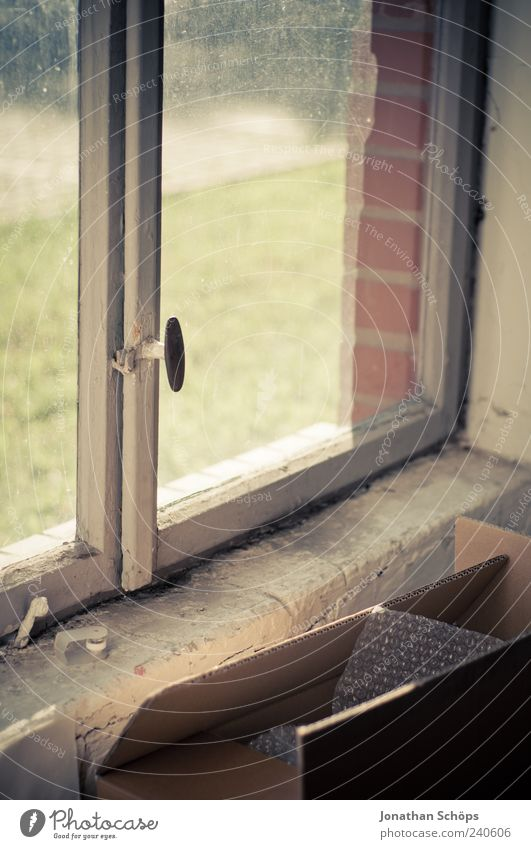Cardboard box in front of window [rickety, beautiful] Wood Glass Brick Old Esthetic Window Window pane Crate Door handle Sunlight Old building Decline Dirty