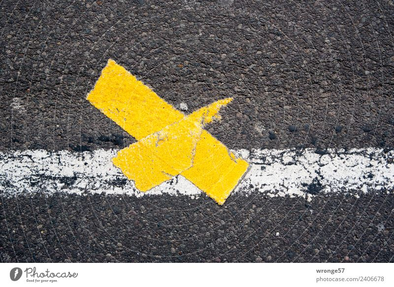 Timeless plaster on it. Street Signs and labeling Town Yellow Black White Traffic lane Lane markings Crucifix Landscape format Asphalt Colour photo