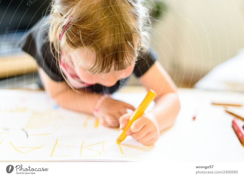 Girl writing with a yellow pencil Writing Write Draw Human being Feminine Child Toddler Infancy 1 3 - 8 years Paper Pen Near Natural Multicoloured Education Joy