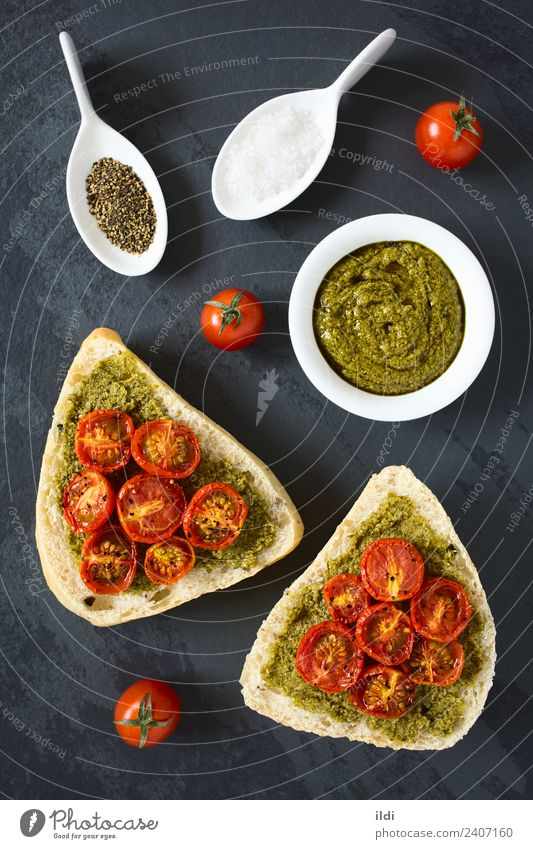 Bread Roll with Pesto and Roasted Tomato Vegetable Breakfast Fresh Healthy food olive pesto roasted topping Spread Sauce Basil salt pepper condiment Snack