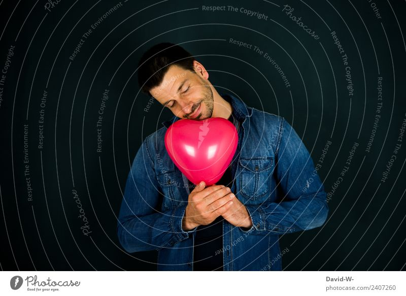 a man in love, dreaming, holding a heart-shaped balloon in his hands Man Balloon Heart-shaped Love Romance romantic Infatuation In love Emotions Colour photo
