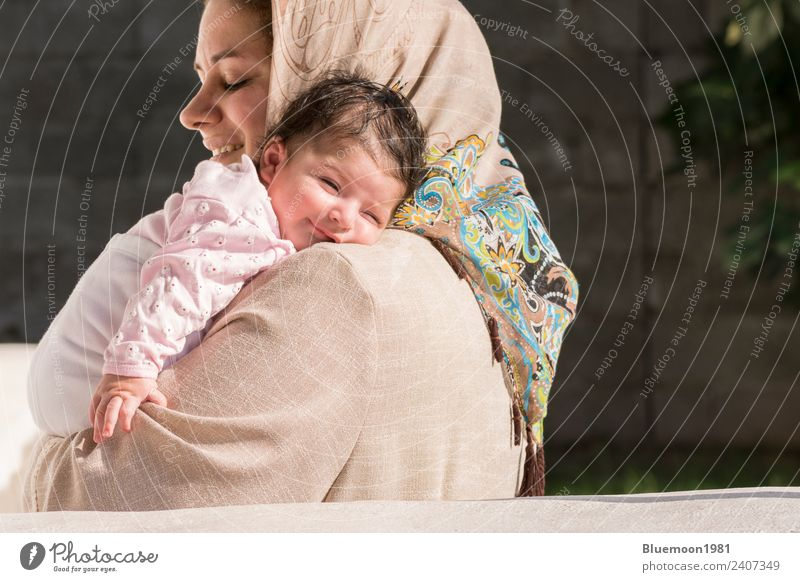 Muslim mother embraced a newborn baby in outdoor Woman Child Human being Beautiful Relaxation Loneliness Joy Adults Lifestyle Religion and faith Healthy