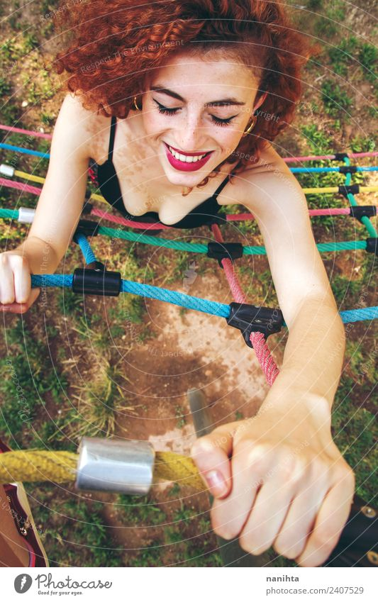 Young redhead woman climbing in a park Lifestyle Style Joy Beautiful Hair and hairstyles Freckles Wellness Fitness Sports Training Practice Human being Feminine