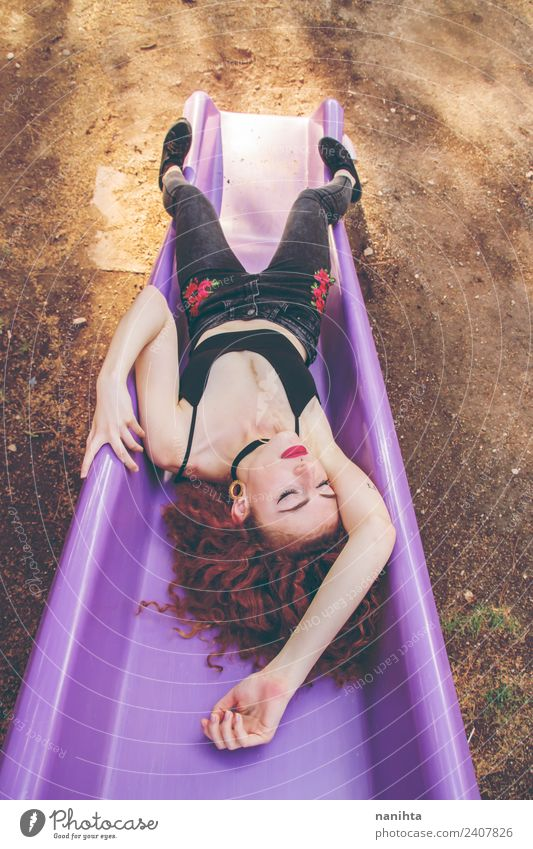 Young redhead woman sleeping in a slide Lifestyle Style Wellness Harmonious Relaxation Leisure and hobbies Human being Feminine Young woman Youth (Young adults)