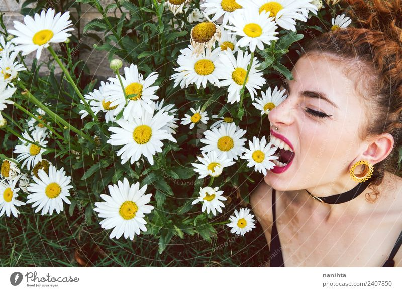 Young woman biting flowers Lifestyle Style Exotic Beautiful Human being Feminine Youth (Young adults) 1 18 - 30 years Adults Environment Nature Plant Spring