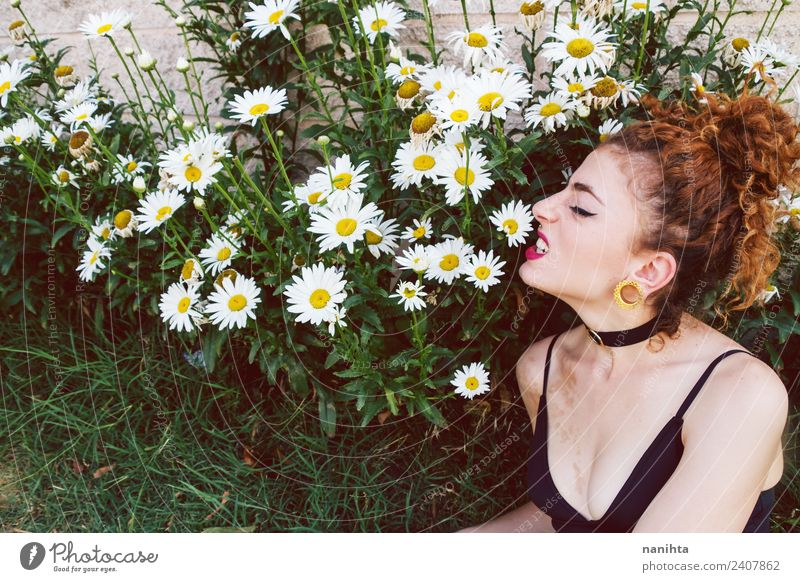 Young woman angry in a garden of daisies Lifestyle Style Design Beautiful Leisure and hobbies Human being Feminine Youth (Young adults) 1 18 - 30 years Adults