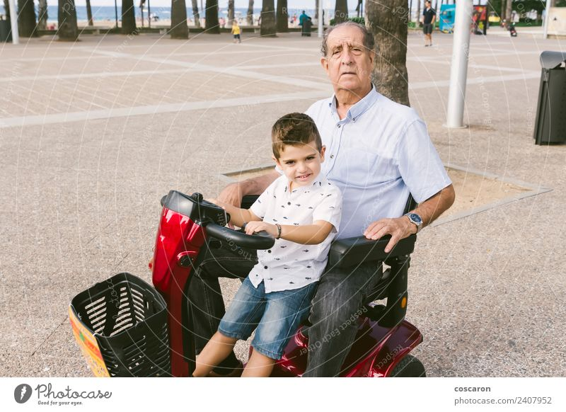 Grandfather and grandson with a electric wheelchair Summer Chair Child Engines Human being Boy (child) Man Adults Nature Transport Vehicle Old Mobility