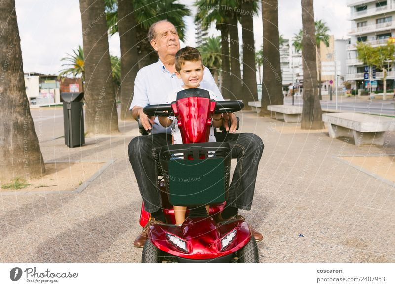 Grandfather and grandson with a electric wheelchair on vacation Summer Chair Child Engines Human being Boy (child) Man Adults Nature Transport Vehicle Old