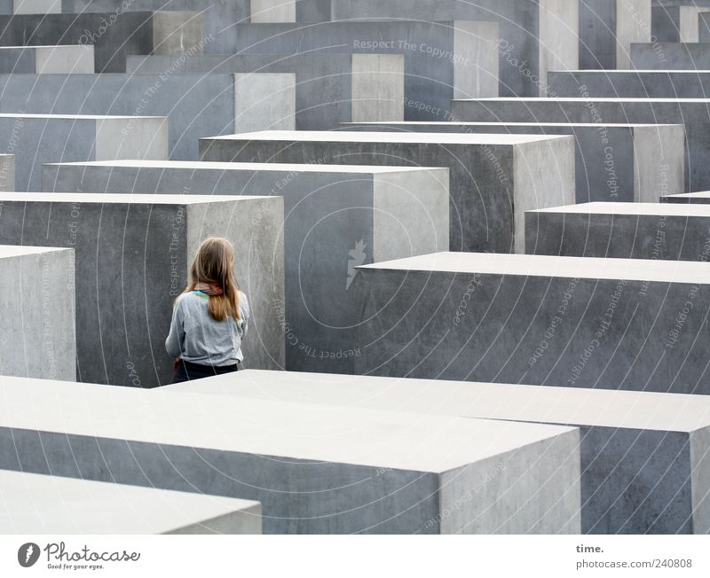 Trying to grasp the immeasurable girl Monument Stone Gray Stelenfeld Berlin Memory Cuboid Corridor Visit Inspection Structures and shapes Shadow Sunlight