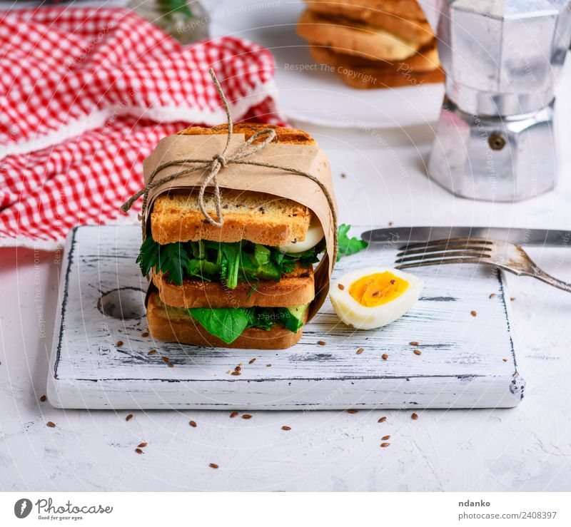 sandwich of French toast Meat Vegetable Lettuce Salad Bread Breakfast Lunch Dinner Vegetarian diet Knives Fork Table Eating Fresh Delicious Brown Green White