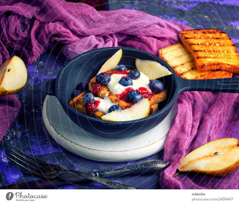 French toast with berries Fruit Bread Dessert Candy Breakfast Lunch Pan Fork Table Fresh Delicious White french cream food background whipped Cast iron vintage