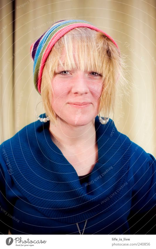 arbitrary_0 Feminine Young woman Youth (Young adults) Hair and hairstyles Face Sweater Cap Blonde Bangs Smiling Illuminate Authentic Brash Friendliness
