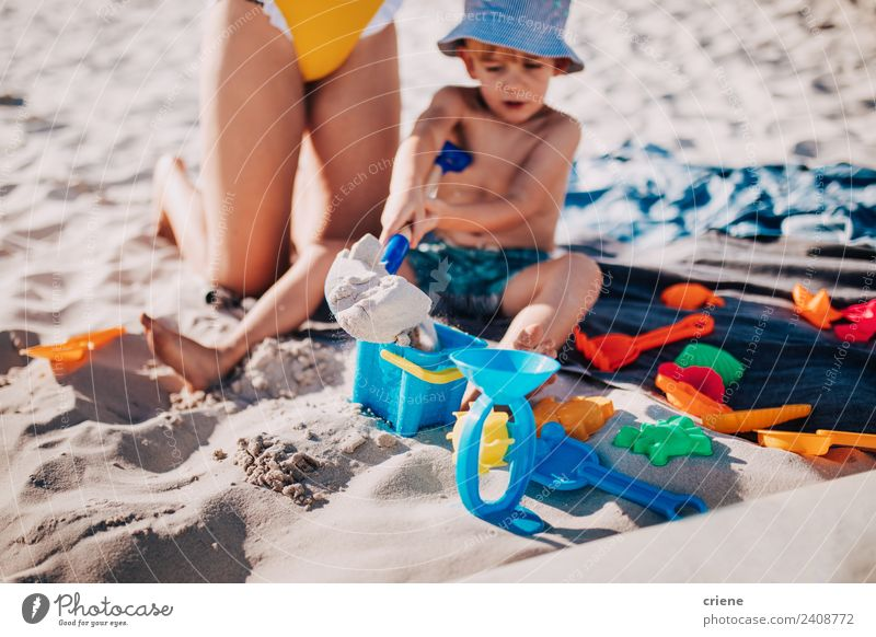 little caucasian boy playing in the sand at the beach Lifestyle Joy Happy Playing Vacation & Travel Summer Sun Beach Ocean Child Human being Boy (child) Infancy