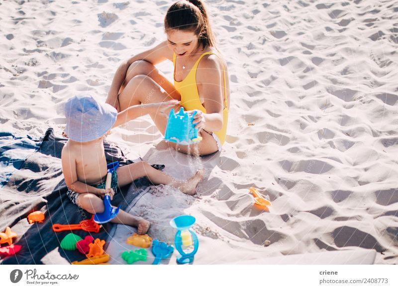 caucasian mother and son having fun at the beach Woman Child Nature Vacation & Travel Summer Joy Beach Adults Lifestyle Family & Relations Building Boy (child)