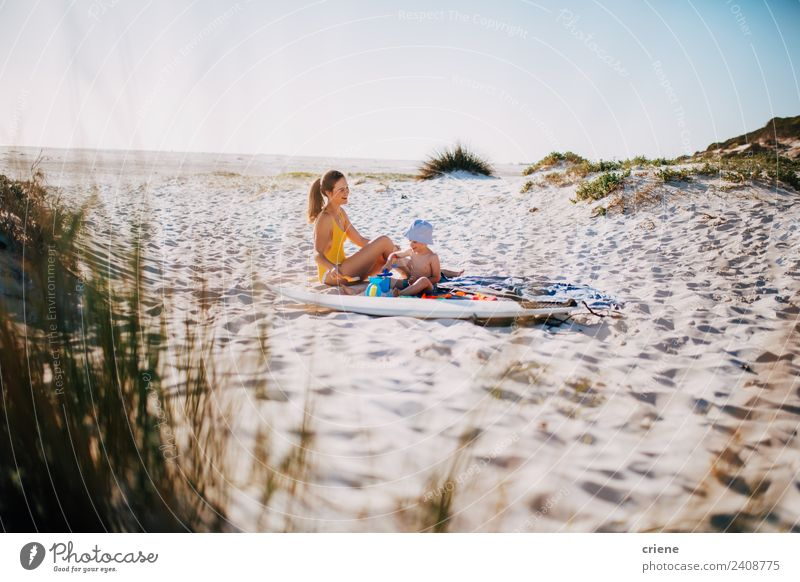 happy caucasian mother and son sitting in dunes Lifestyle Happy Vacation & Travel Summer Beach Child Boy (child) Woman Adults Man Parents Mother