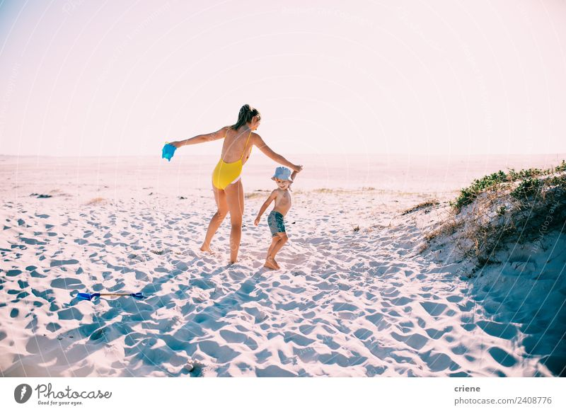 caucasian mother and son having fun at the beach Woman Nature Vacation & Travel Summer Beautiful Sun Beach Adults Lifestyle Family & Relations Boy (child) Happy