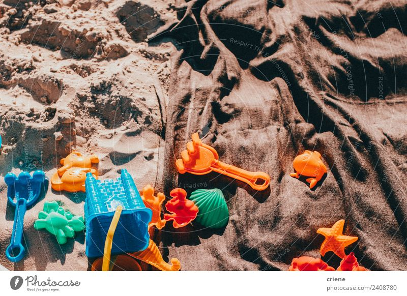 close up of some kid toys in the sand Joy Beautiful Summer Beach Infancy Nature Sand Toys Blue Green blanket pail orange Exterior shot Close-up Deserted