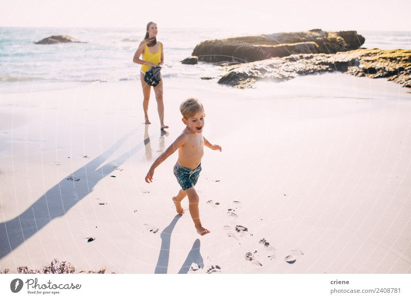 caucasian mother and son walking at the beach close to the water Woman Child Nature Vacation & Travel Summer Beautiful Sun Ocean Joy Beach Adults Coast Happy