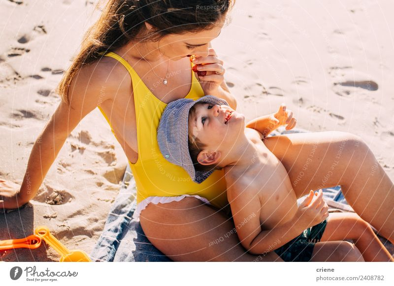 happy caucasian mum and his son eating some fuits at the beach Woman Child Blue White Beach Adults Yellow Love Family & Relations Happy Sand Fruit Nutrition