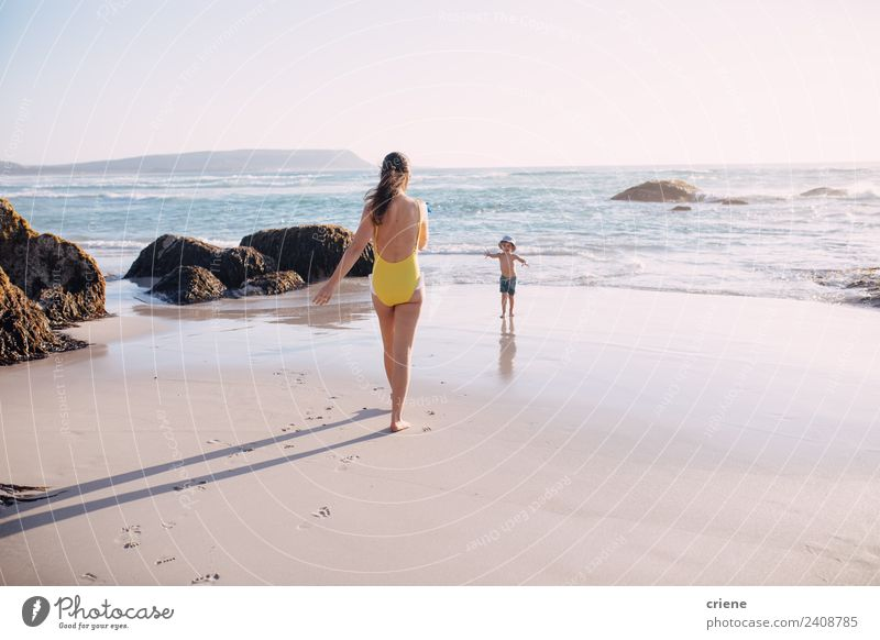 caucasian mother and sun are walking into the water at the beach Woman Child Human being Vacation & Travel Summer Blue Sun White Ocean Relaxation Beach Adults