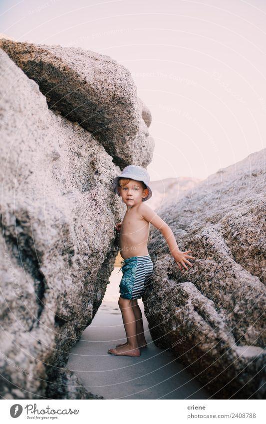 little caucasian boy climbing between big rocks at the beach Summer Beach Climbing Mountaineering Child Toddler Boy (child) Infancy Warmth Rock Swimming trunks