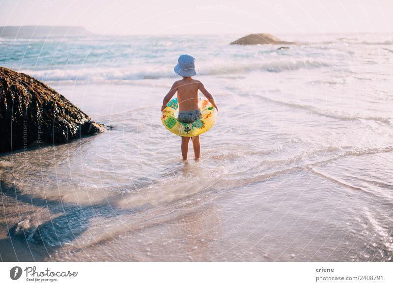 little caucasian boy at the beach with his inflatable ring Joy Happy Beautiful Leisure and hobbies Playing Vacation & Travel Summer Sun Beach Ocean Child