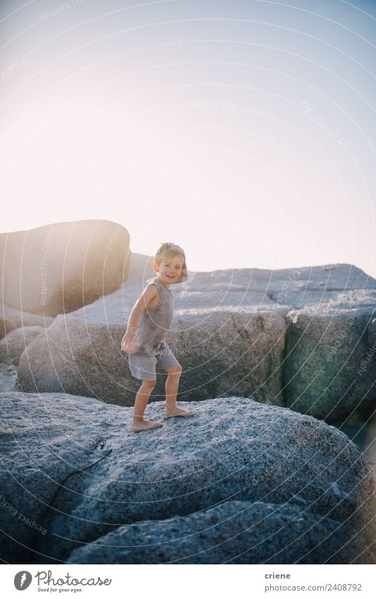 little caucasian boy is climbing on rocks at the beach Joy Happy Vacation & Travel Summer Sun Beach Climbing Mountaineering Child Toddler Boy (child) Infancy