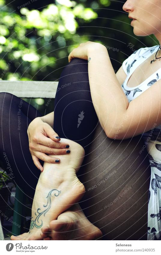 300 - short break Human being Woman Adults Head Arm Legs Feet 1 Tights Sit Tattooed Curlicue Colour photo Exterior shot Day Full-length Ankle