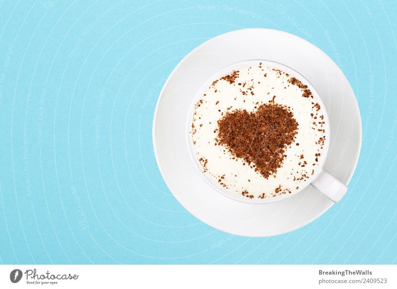 Close up cup of cappuccino over blue background Breakfast Beverage Hot drink Hot Chocolate Coffee Latte macchiato Mug Heart Blue White Joy Colour Saucer