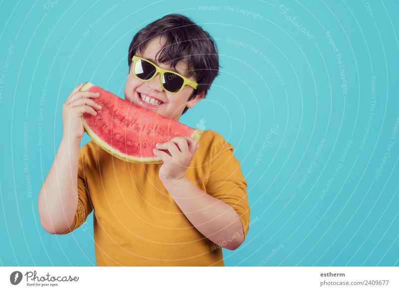 Happy child with sunglasses eats watermelon Child Human being Joy Eating Lifestyle Healthy Boy (child) Food Fruit Masculine Nutrition Infancy Fresh To hold on