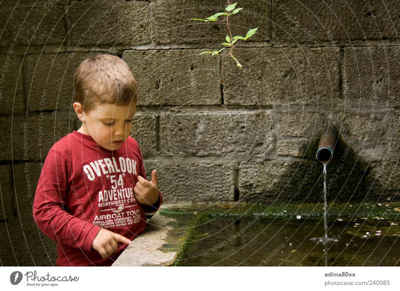 inquisitiveness Boy (child) Observe Think Discover Experience Curiosity Colour photo Multicoloured Exterior shot Sunlight Downward Well Water Indicate