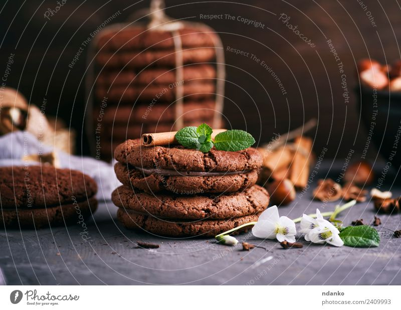 round chocolate chip cookies Dessert Candy Nutrition Flower Dark Delicious Brown Black background food Stack sweet Baking biscuit holiday Tasty Snack Mint