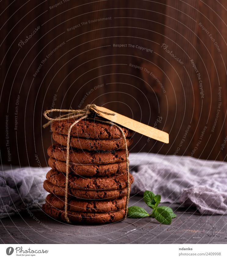 round chocolate cookies Dessert Candy Nutrition Rope Eating Delicious Brown Black background food Stack sweet Baking biscuit holiday Tasty Snack Mint tag