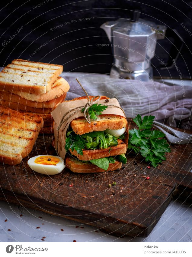 toast and lettuce leaves and boiled egg Meat Vegetable Bread Breakfast Lunch Dinner Vegetarian diet Coffee Table Eating Fresh Delicious Brown Green White