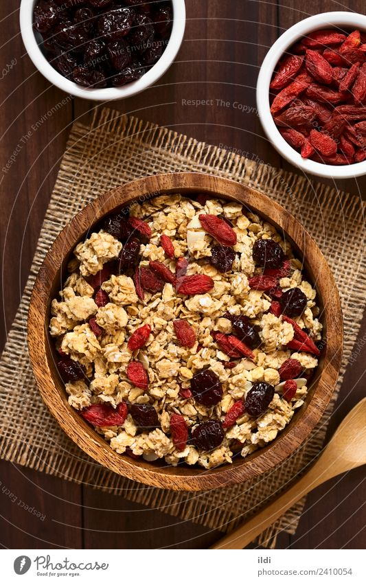 Crunchy Oatmeal Cereal with Almond and Dried Berries Healthy Fruit Breakfast Meal Vertical Rustic Mix Snack Cowberry
