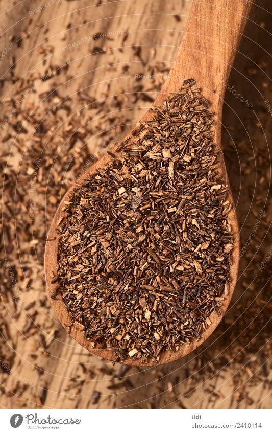 Rooibos Herbal Tea on Wooden Spoon Herbs and spices Beverage Red food drink rooibos bush Red bush rooibosch herbal dry African Dried Rustic overhead Vertical