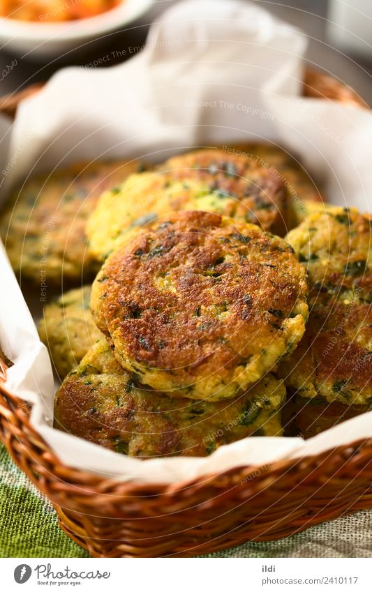 Zucchini, Couscous and Parsley Fritter Dish Healthy Meal Vegetarian diet Vertical Basket Snack Home-made