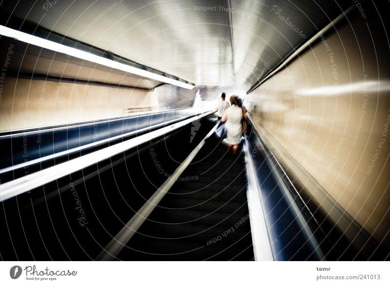 Metro station escalator Capital city Train station Tunnel Transport Means of transport Public transit Rail transport Underground Esthetic Speed Gold Gray Black