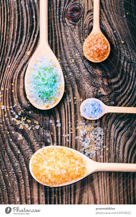 Colorful sea salt in wooden spoons put on old wooden table Spoon Lifestyle Medical treatment Wellness Relaxation Spa Table Nature Container Wood Natural Above