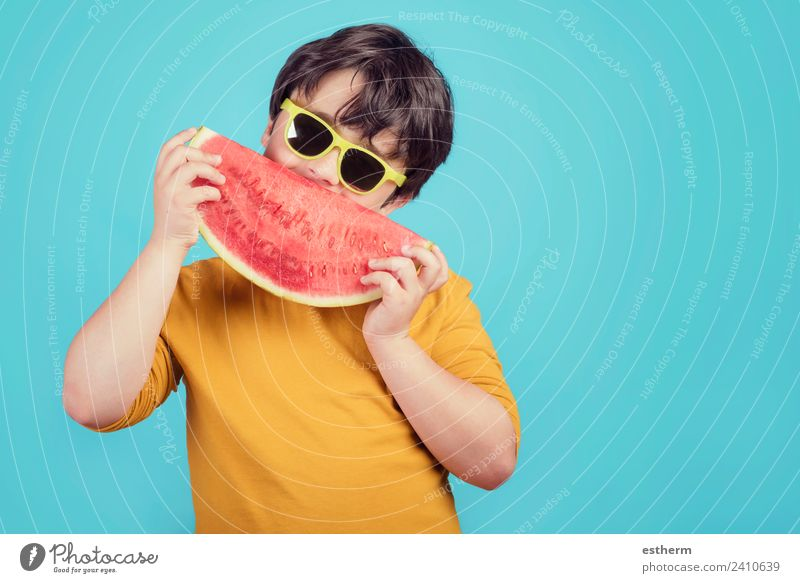 Happy child with sunglasses eats watermelon Child Human being Joy Eating Lifestyle Healthy Laughter Boy (child) Food Fruit Masculine Nutrition Infancy Smiling
