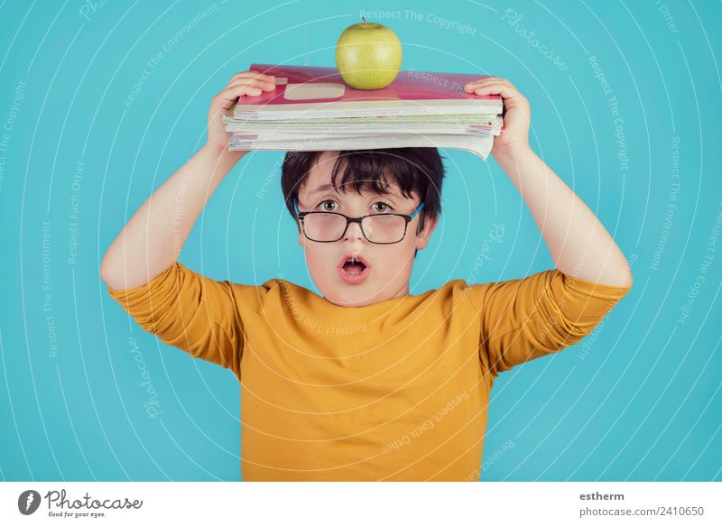 surprised boy with books and apple Child Human being Lifestyle Emotions Boy (child) School Think Masculine Infancy Study Fitness Eyeglasses Curiosity To hold on